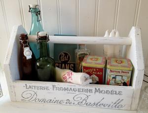 Gammal verktygslåda med fransk vintage-text